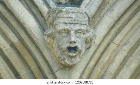 Corbel Head on The West Front of Salisbury Cathedral K, Gargoyle on Early English Gothic Cathedral, shallow depth of field split toning horizontal photography