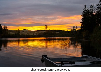 Corbett Lake at Sunrise with boat in foreground near Merritt British Columbia Canada in the summer