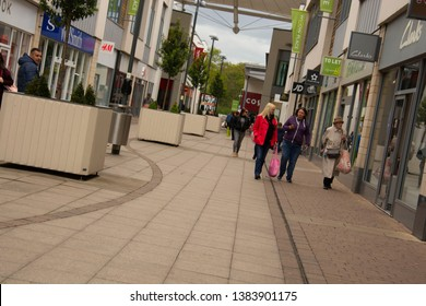 Corby, UK - 28,04,2019 - Outdoor street, shopping centre. People makind shopping in Uk, Copy space.