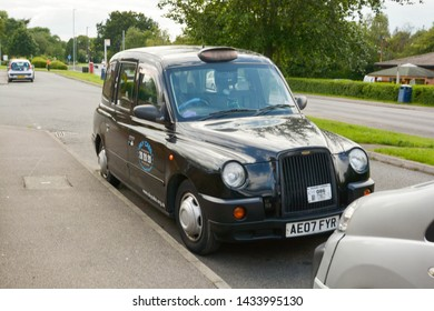 Corby, U.K., june 20 2019 - typicalenglish taxi black cab in the street
