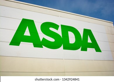 Corby, UK. March 19, 2019: The sign for the Asda store on wall. Asda logo isolated.