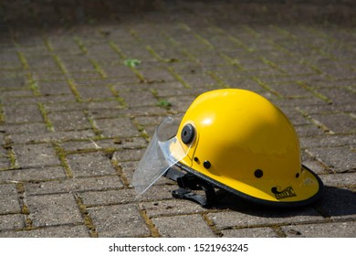 Corby, U.K. September 13, 2019 - one yellow helmet on the ground at British fire engine open day family event at fire station in Corby