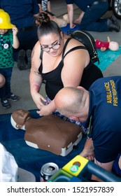 Corby, U.K. September 14, 2019 - first aid medical massage to the heart at British fire engine open day family event at fire station in Corby,