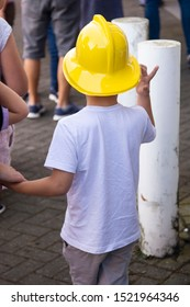 Corby, U.K. September 14, 2019 - kid with yellow helmet for firefighters at British fire engine open day family event at fire station in Corby,