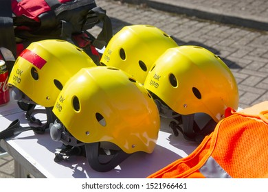 Corby, U.K. September 14, 2019 - yellow helmets on the ground at British fire engine open day family event at fire station in Corby