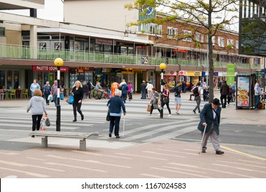 Corby, United Kingdom - august 28, 2018: Crowd of anonymous people walking on busy city street.