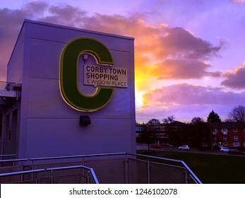 Corby, United Kingdom. December 1, 2018 - Corby shopping centre sign on modern building. Copy space. Toned. Mobile phone photography.
