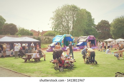 Corby, United Kingdom. June 01, 2018. Celebrating child care day. Many people at an outdoor festival.
