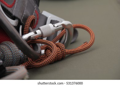 Cord and carabiner on the harness