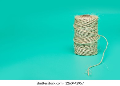 Cord packing tape roll on a bright green background