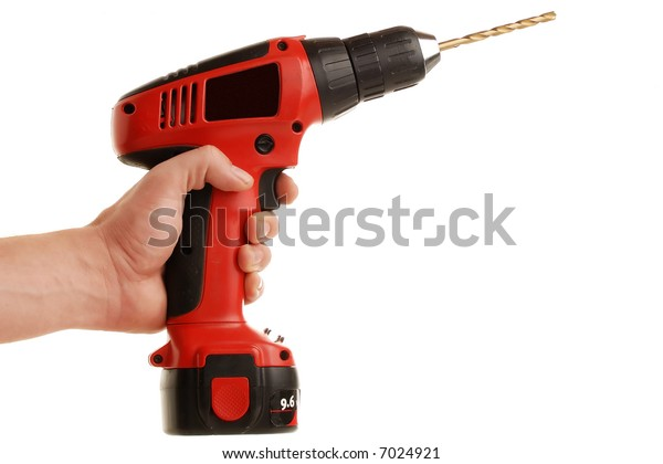 cordless drill being held by male hand isolated on white. White space for text