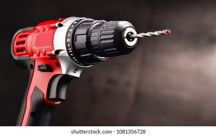 Cordless drill with drill bit working also as screw gun.
