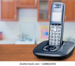 Cordless phone with cradle on white background