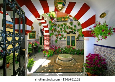 Cordoba, Andalusia / Spain - May 05 2015: Patio (courtyard) of a house in the historic city of Cordoba during Courtyards Festival in Cordoba, Andalusia, Spain