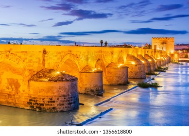 Cordoba, Andalusia, Spain. Puente Romano, Guadalquivir river and Calahorra Tower at sundown.