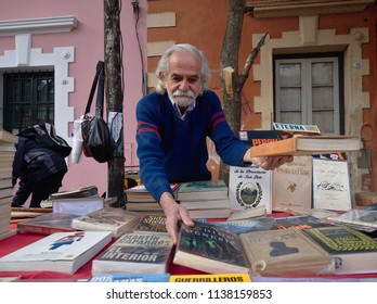 Cordoba, Argentina - 2017: A man sells books at a flee market in the Güemes district.