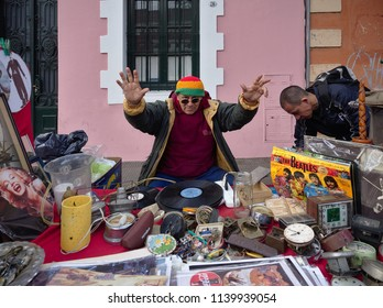 Cordoba, Argentina - 2018: A man sells antiques at a flee market in the Güemes district.