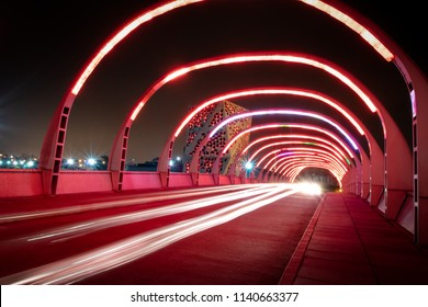 Cordoba, Argentina - May 7, 2018: Puente del Bicentenario (Bicentenary Bridge) at night with Centro Cívico del Bicentenario (Bicentenary Civic Center) on background - Cordoba, Argentina