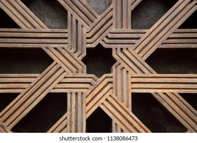 Cordoba historical centre, Andalusia, Spain. Unesco World Heritage site. Detail of typical old arabesque, intricate, wood and bronze paneled door in Islamic design.