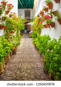 CORDOBA, SPAIN - 16 MAY, 2018: Nice patio in the old town of Cordoba with flowers on May 16, 2018