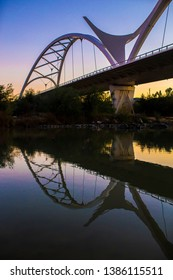 Cordoba, Spain - 2018 Dec 9th: Ibn Abbas Firnas Bridge from Guadalquivir river bank, Cordoba, Spain. Designed by JL Manzanares Japon
