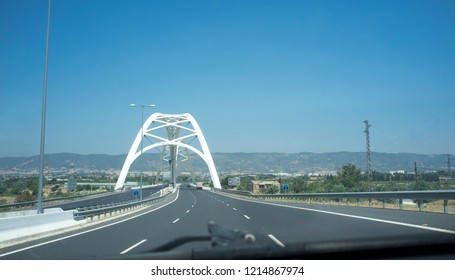 Cordoba, Spain - 2018 july 10th: Driving by Ibn Abbas Firnas Bridge close to Cordoba City. View from the inside of the car. Designed by JL Manzanares Japon