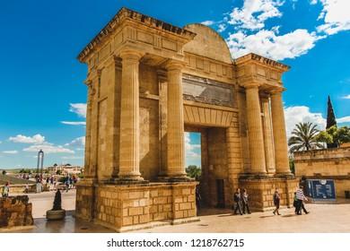 "Cordoba, Spain - 5/3/18: Roman arch bridge gate in Cordoba Spain. The Puerta del Puente (Spanish: ""Gate of the Bridge"") is a Renaissance gate in Córdoba, Andalusia"