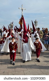 CORDOBA, SPAIN APRIL, 2: Penitents, unidentified children dressed with processional suit, and unidentified people in Easter Monday procession. On April 2 , 2012 in Cordoba