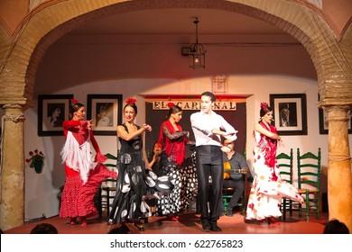 Cordoba, Spain - April 20, 2016: Flamenco dancers and singers performing at Tablao El Cardenal Flamenco Show on April 20, 2016 in Cordoba, Spain