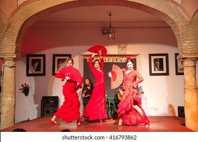 Cordoba, Spain - April 20: Flamenco dancers and singers performing at Tablao El Cardenal Flamenco Show on April 20, 2016 in Cordoba, Spain
