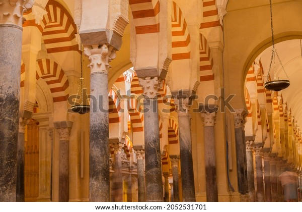 CORDOBA, SPAIN - August 11, 2021 - Arches within the Prayer Hall of the Mezquita (Mosque), Cordoba, Spain