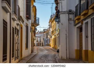 Cordoba, Spain - August 16 2018: Typical narrow street in the jewish quarter of Cordoba.  Andalusia, Spain