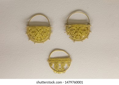Cordoba, Spain - Dec 7th, 2018: Gold hoop earrings from Caliphal Period, 10th Century at Cordoba Archaelogical Museum, Spain
