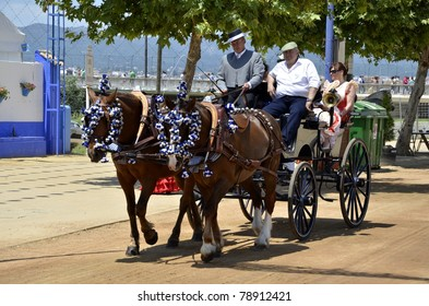 CORDOBA, SPAIN - JUNE 08: Unidentified persons ride in a carriage at the Cordoba Fair on June 08, 2011 in Cordoba, Spain. The fair is a celebration full of attractions including carriages exhibition
