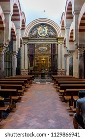 Cordoba, Spain - June 20 :  A person sitting for prayer in the Mosque Church of Cordoba, Spain, Europe