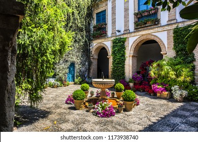 CORDOBA, SPAIN - JUNE 3, 2017: In courtyard garden of Viana Palace built in XV century. Viana Palace is tourist attraction known for its 12 magnificent patios and a garden. The reception courtyard.