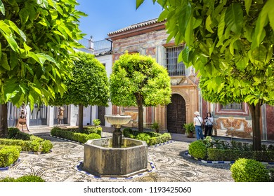 CORDOBA, SPAIN - JUNE 3, 2018: Cordoba old Hospital of Charity courtyard: here are located Museum of Fine Arts and Museum of Julio Romero de Torres. Cordoba Square of Colt (Plaza del Potro).