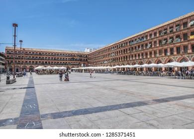 CORDOBA, SPAIN - JUNE 3, 2018: View of famous Corredera Square (Plaza de la Corredera, 17th century). Plaza de la Corredera is a rectangular square - one of the largest squares in Andalusia.