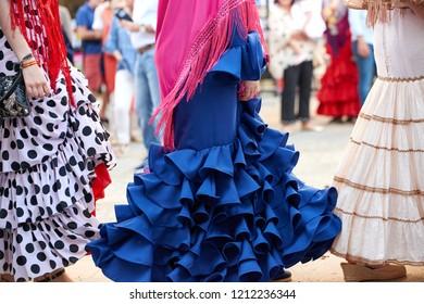 Cordoba, Spain - May 06 2018: Close up view of women wearing traditional spanish dresses (flamenco)