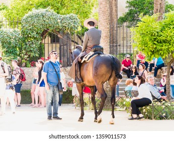 CORDOBA, SPAIN - MAY 08: Traditional andalusian horseman riding in a park during the Festival of the Patios on May 08, 2015 in Cordoba, Spain.