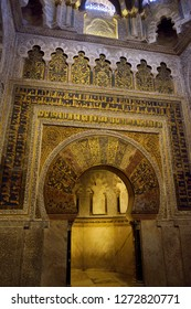 Cordoba, Spain - May 2, 2015: Mihrab qibla wall with gold mosaic design and caligraphy at the Prayer Hall of the Cordoba Cathedral Mosque