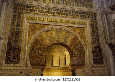 Cordoba, Spain - May 2, 2015: Mihrab with gold mosaic design and caligraphy at the Prayer Hall of the Cordoba Cathedral Mosque