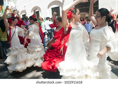 CORDOBA, SPAIN - MAY 3: Undefined people performing a sevillana dance in the street, in San Nicolas square, celebrating Cordoba´s Cruxes, on may 3, 2014, in Cordoba, Spain
