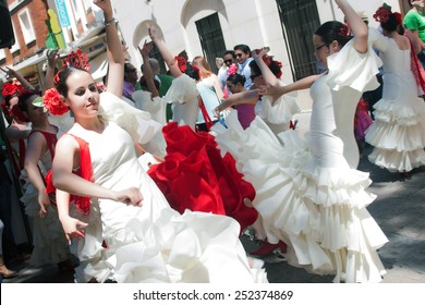 CORDOBA, SPAIN - MAY 3: Women performing a sevillana dance in the street, in San Nicolas square, celebrating Cordoba´s Cruxes, on may 3, 2014, in Cordoba, Spain
