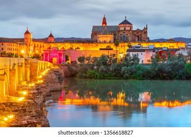 Cordoba, Spain. Mezquita - Great Mosque and Roman Bridge on Guadalquivir, sunset scene in Andalusia.