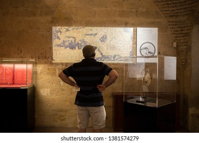 Cordoba, Spain - Sept 8th, 2018: Visitor at Calahorra Tower Museum, Cordoba, Spain. He has audio tour device