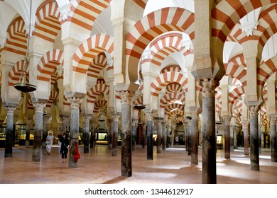 CORDOBA, SPAIN - SEPTEMBER 1, 17: Pillars and horseshoe-shaped arches with red and white stripes in the interior of Mezquita - the Great Mosque of Cordoba, Cathedral of Our Lady of the Assumption.