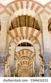 CORDOBA, SPAIN - SEPTEMBER 1, 17: Pillars and arches with red and white stripes in the interior of Mezquita - the Great Mosque of Cordoba, Cathedral of Our Lady of the Assumption.