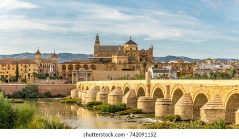 CORDOBA,SPAIN - OCTOBER 1,2017 - View at the Mosque - Cathedral with Old Roman bridge in Cordoba. Cordoba is a city in Andalusia, southern Spain, and the capital of the province of Cordoba.