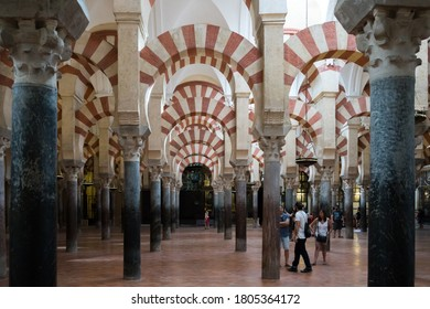 Cordoba,Spain-august 11, 2017:people admire the columns inside the beautiful Mezquita of Cordoba